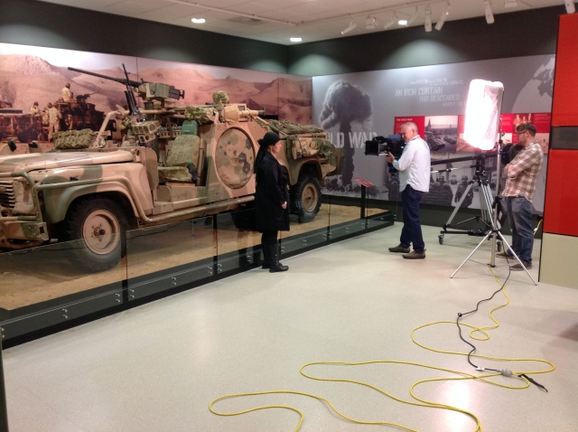 Fatima Killeen filming in the Conflicts 1945 to Today exhibition at the Australian War Memorial