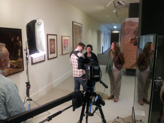 "Fatima filming in front of the ""Besieged"" artwork on display at the Australian War memorial"