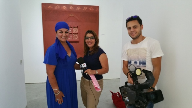 Fatima Killeen after an interview with the film crew from 2M TV at the MAC-A Gallery located on the beachfront in Asilah, Morocco.
